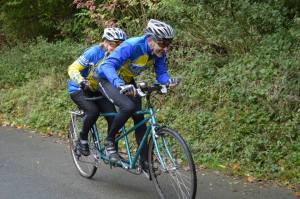 Nick & Jane riding to a sub 3 minute time on the tandem